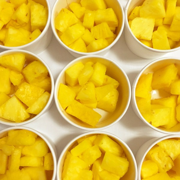 Cups of fresh Dole pineapple as an after-workout snack