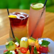 Cherry Bourbon Sour, left, and Watermelon Mojito, right, with the Watermelon-Heirloom Tomato Salad at True Food Kitchen