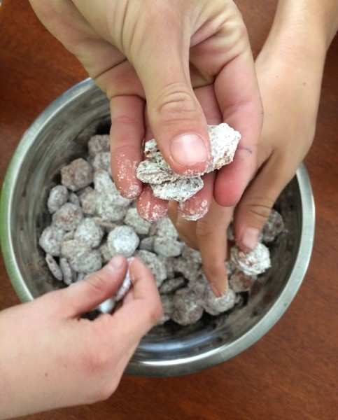 three kids eat puppy chow